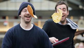 Annual Greenwich Market pancake warmup race held in London
