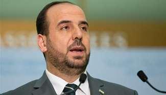 Syria's opposition delegation leader addresses media in Geneva