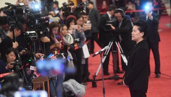 Ministers receive interviews after opening meeting of 5th session of 12th NPC