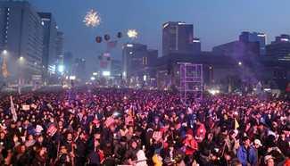 Spotlight: South Koreans celebrate Park's ouster in last, festive candlelight rally