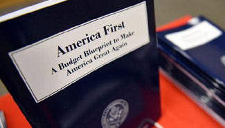 Trump unveils first budget blueprint with big rise for defense, cuts across gov't