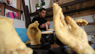 Palestinian artist uses beeswax to produce models of human limbs
