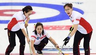 China wins Denmark 7-5 during World Women's Curling Championship