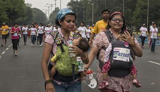 People participate in Pinkathon in Kolkata, India