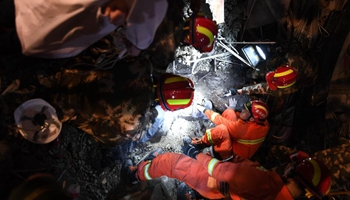 Rescuers work at accident site after scaffold collapsed in central China