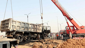 13 people killed in suicide truck bomb in south of Iraq's Baghdad