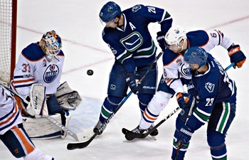 National Hockey League match: Edmonton Oilers vs. Vancouver Canucks