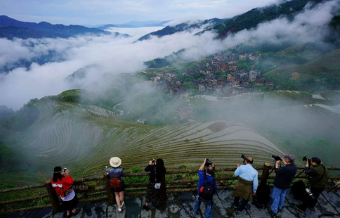 Terraces shrouded by clouds in south China's Guangxi