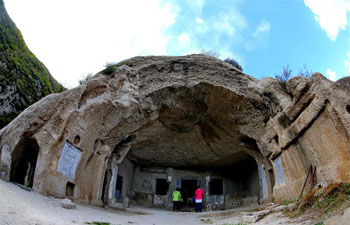 Tourists visit rock cave of Northern Wei Dynasty in north China's Hebei