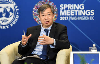 Yi Gang speaks at forum during IMF/World Bank Spring Meetings