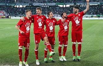 Bayern crush Wolfsburg 6-0 to defend Bundesliga title