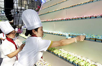 Cupcake makers build cake pagoda in central China's Luoyang
