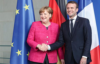 Merkel meets visiting French President Macron in Berlin