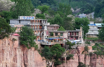 Villagers in China's Henan cast off poverty thanks to Guoliang cliff corridor