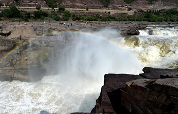 In pics: Hukou Waterfall of Yellow River in N China