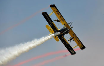 Aerobatics aircraft perform at air show in C China's Henan