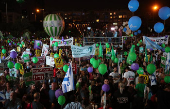 People take part in peace rally in Tel Aviv, Israel