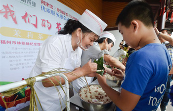 Children learn to make Zongzi in preparation for Dragon Boat Festival