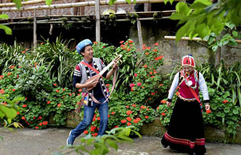 In pics: Nu ethnic couple and their family stay in SW China's village