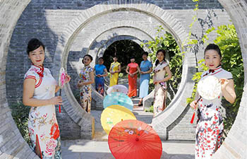 Cheongsam show held at Sanshuiwan scenic spot in Taizhou City