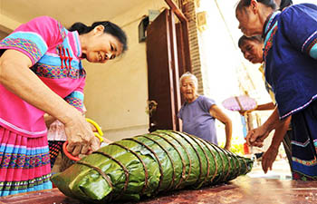 "Big pillow-shaped ""zongzi"" made for Dragon Boat Festival in Guangxi"