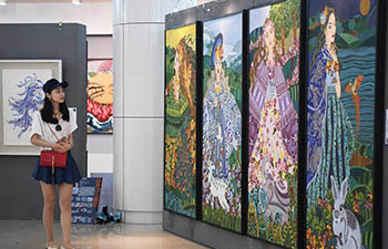 Graudates' art works displayed at exhibition in Chongqing