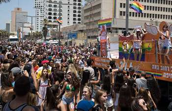 People take part in Tel Aviv Pride Parade in Israel