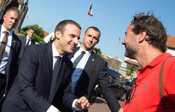 Macron greets supporters after 2nd round of parliamentary elections