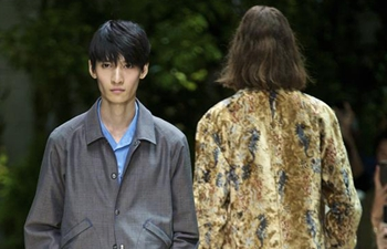 Models present Salvatore Ferragamo creations at Milan Men's Fashion Week