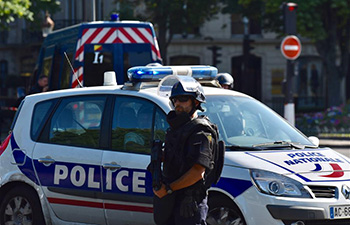 Car with explosives rams into police van in Paris, driver dies: minister