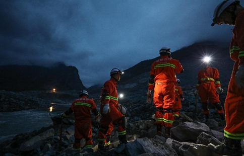 15 found dead in SW China landslide burying 120