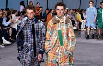 Models present creations of Sacai at Paris Men's Fashion Week