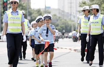 Pupils learn knowledge from traffic police in N China's Hebei