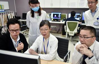 Pic story: Doctor travels between HK, Shenzhen for cooperation
