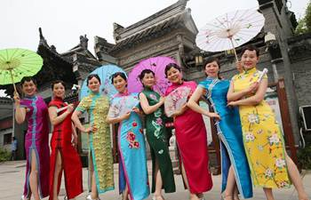 People present qipao dresses at park in E China's Zhejiang