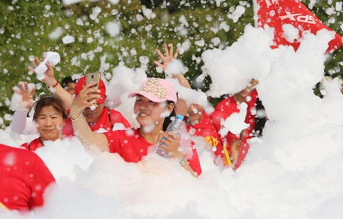 People take part in bubble running in central China's Hubei