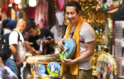 Tourists visit Int'l Bazar at Urumqi in NW China's Xinjiang