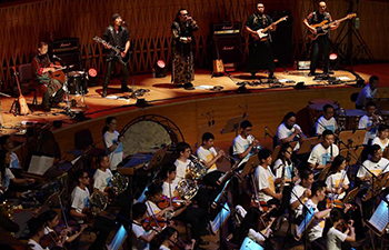 Concert combining symphony with rock music held in Shanghai