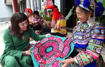 In pics: ethnic embroidery show in SW China's Yunnan