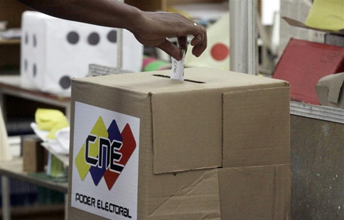 Venezuela sees both sides contest legitimacy of their polls