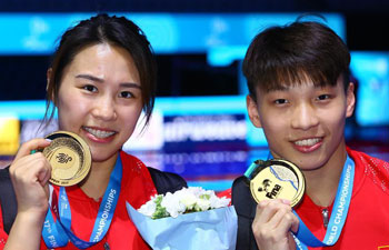 China claims title of Mixed 3m Springboard Synchro at FINA worlds