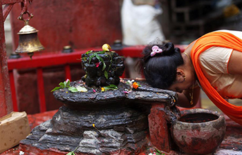 Hindu women offer prayers on Shrawan Somvar in Kathmandu, Nepal