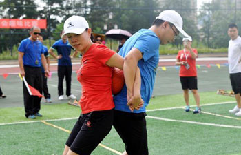 People participate in fun sports games in China's Guizhou