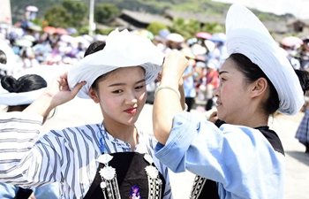 Bouyei ethnic group hold headscarves contest in SW China's Guizhou