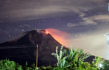 Volcanic materials and ashes spew from Mount Sinabung in Indonesia