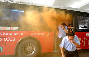 Staff members of bus system participate in emergency drill in E China
