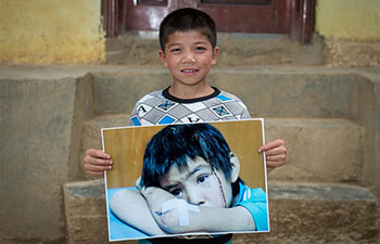 "Pic story: life of ""Big-eyed Boy"" after Ludian earthquake in SW China"