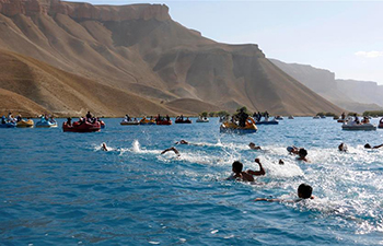 Afghan men participate in swimming competition in Bamyan province