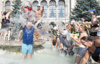 People participate in annual water fight flashmob event in Hungary