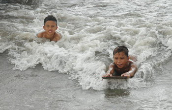 Children surf at Bantaya in Indonesia